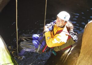 Rappelling into water