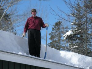 "One winter Kelli sent this picture of Ollie shoveling snow off cottage#5 (""our cottage"")"