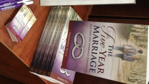 Stack of Five-Year Marriage books - relationship guide