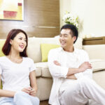 Asian couple chatting about relationship and marital problems at home